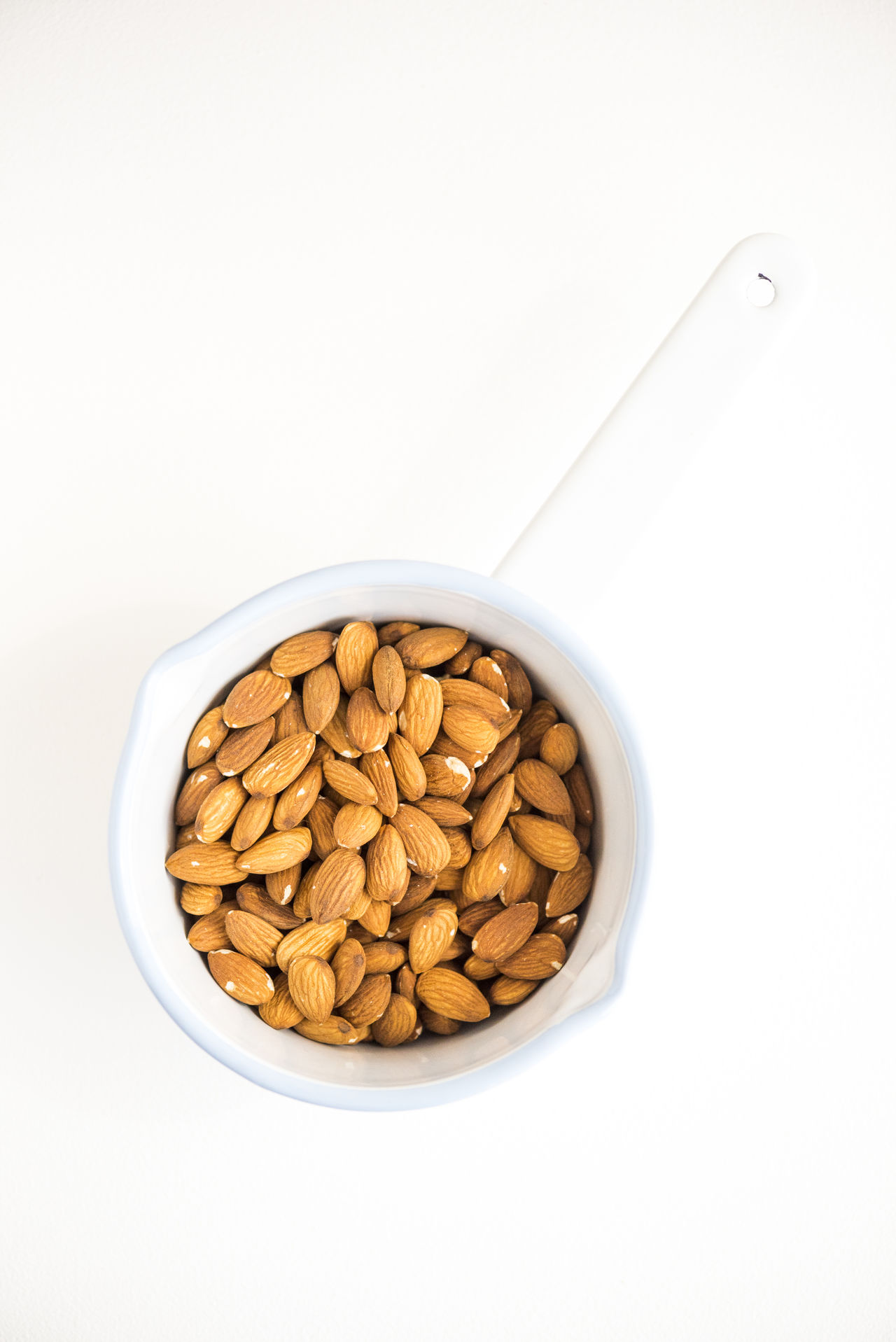 Abundance Almond Bowl Close-up Container Cut Out Directly Above Food Freshness No People Nuts Overhead View Pot Raw Raw Food Ready-to-eat Still Life Studio Shot Top Perspective Top Shot White White Background