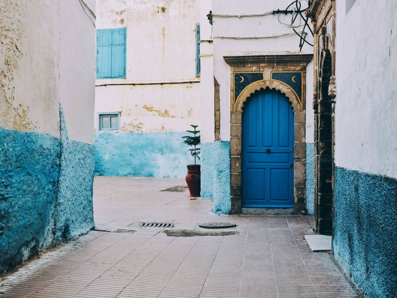 Architecture Built Structure Door Travel Destinations Building Exterior Arch Day No People Outdoors Blue Blue Paint Blue Painted Surface Architecture Art Deco Pastel Colors Pastel Colours Old Town Pretty City Old Architecture Essaouira Morocco Morocco 🇲🇦