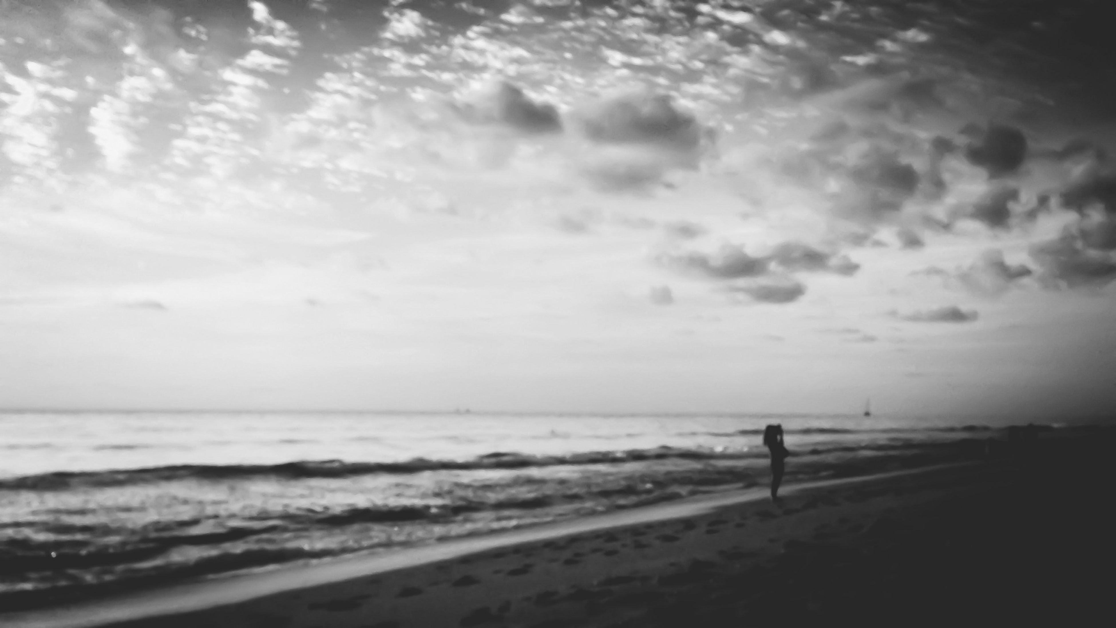 beach, sea, shore, water, sand, horizon over water, sky, wave, tranquility, scenics, tranquil scene, silhouette, cloud - sky, beauty in nature, leisure activity, nature, lifestyles, coastline
