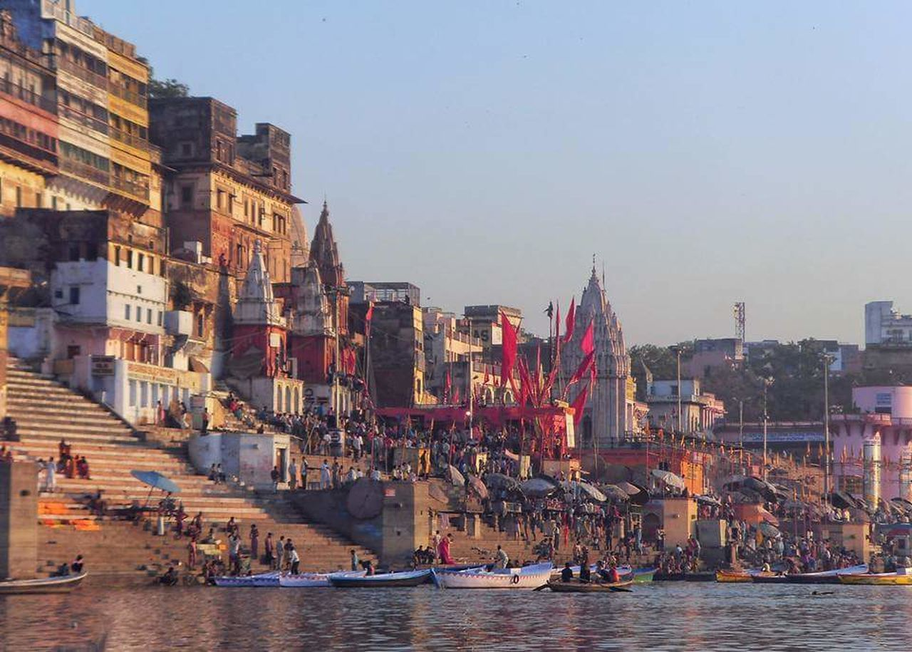 City Travel Destinations Outdoors Sky Business Finance And Industry Building Exterior Water Urban Skyline Cityscape No People Architecture Day City Benaras Varanasi, India Ganges, Indian Lifestyle And Culture, Bathing In The Ganges,