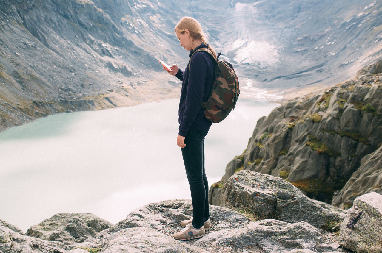 Beautiful stock photos of mobile, At The Edge Of, Backpack, Day, Full Length