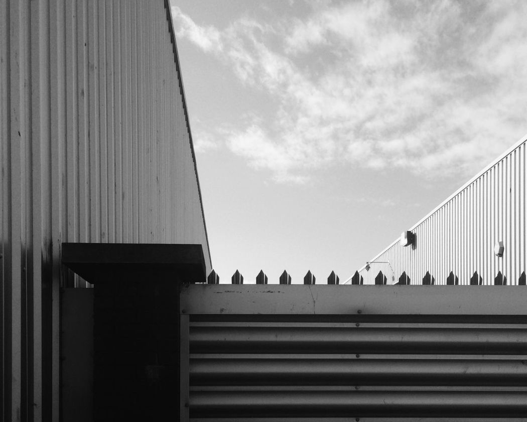 Built Structure Low Angle View Cloud Sky No People Falkirk Retail Park Building Exterior Shadow Corrugated Metal Wall Monochrome Monoart Blackandwhite Black & White Black And White Streetphotography Street Photography Bnw Blackandwhite Photography Photoart Fine Art Photography