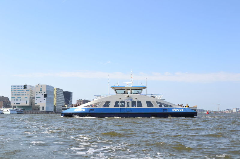 Ferry crossing the IJ River in Amsterdam, The Netherlands Amsterdam Amsterdam City Blue City Day Ferry Ferry Boat Ferry Ride Ferryboat Holland Mode Of Transport Nature Nautical Vessel Outdoors River Sailing Sea Sky The Netherlands Transportation Water Waterfront