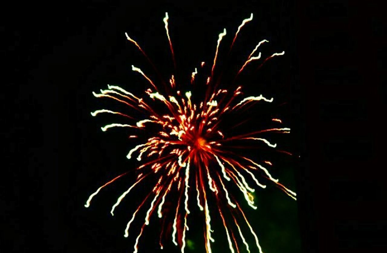 firework display, celebration, firework - man made object, night, exploding, arts culture and entertainment, event, red, long exposure, illuminated, low angle view, no people, motion, outdoors, multi colored, sky, black background
