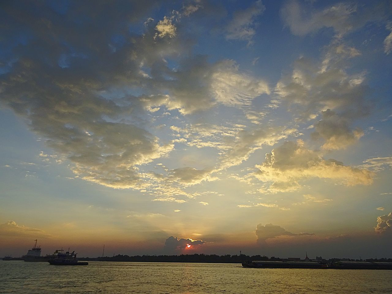 sunset, sky, cloud - sky, water, scenics, beauty in nature, sea, nautical vessel, nature, transportation, tranquility, outdoors, sun, tranquil scene, no people, silhouette, moored, horizon over water, day