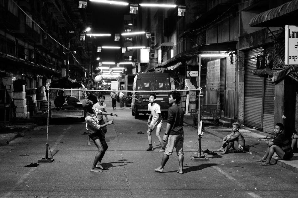 Real People Full Length Lifestyles Large Group Of People Night Outdoors City People Street Street Photography Alley Playing Ball Footvolley Togetherness Sport Black And White Monochrome EyeEm Best Shots EyeEm Gallery Check This Out Popular Photos Kids in Yangon , Myanmar