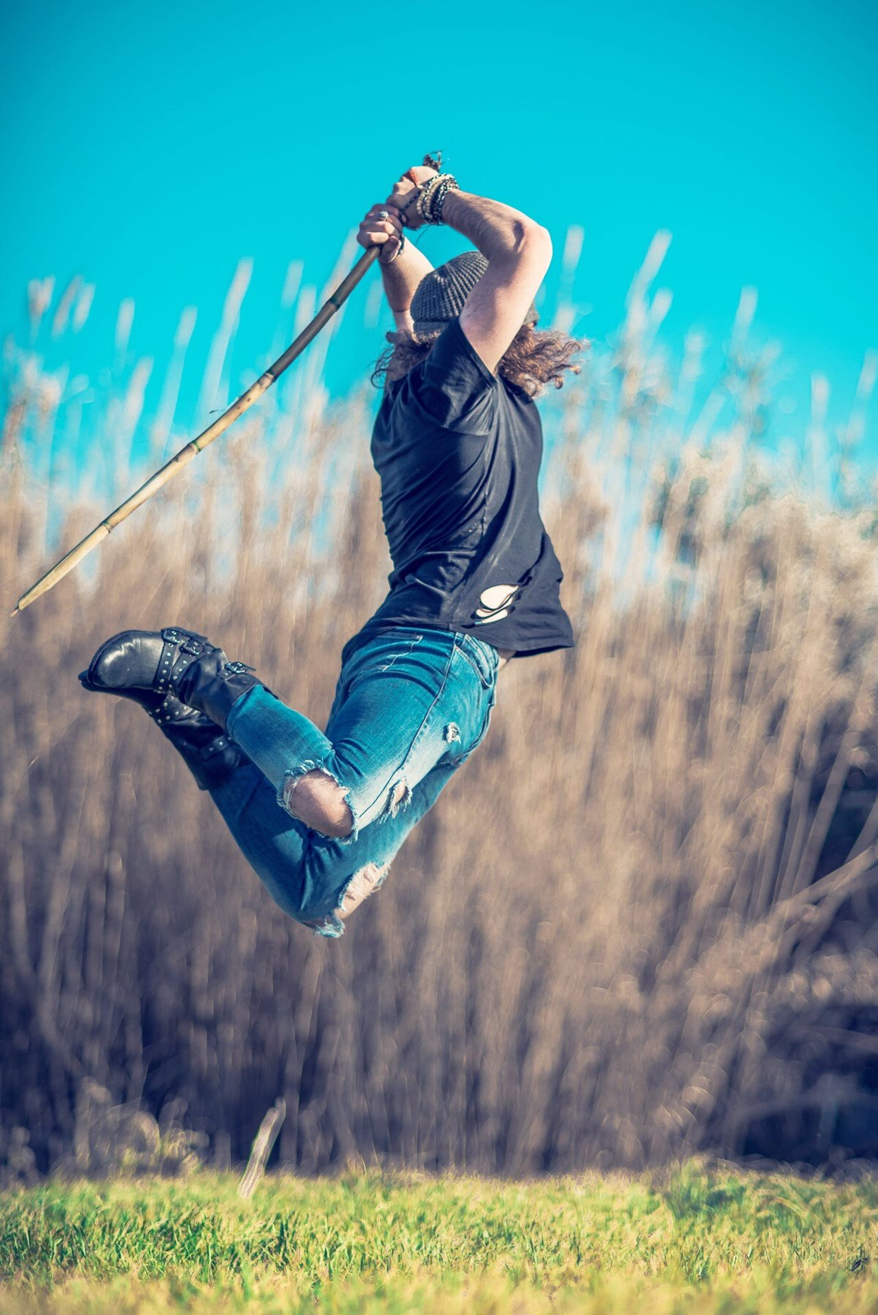 Jumping One Person Mid-air Motion Vitality Full Length Young Adult Childhood Stunt Outdoors People Sky Swing Day Adult