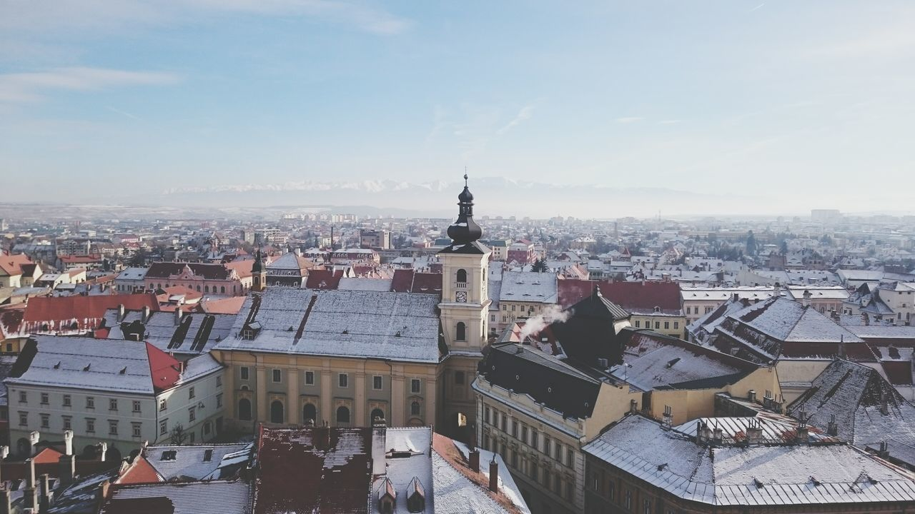 Sibiu, Romania, the Carpathian mountains Cityscape City Architecture Travel Destinations High Angle View Aerial View Sky Tower Outdoors No People Clock Tower Day Skyscraper Winter Sunset Downtown District Built Structure Building Exterior Urban Skyline Politics And Government First Eyeem Photo