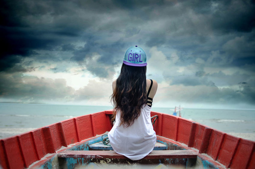 Beauty In Nature Boat Casual Clothing Cloud - Sky Cloudy Cloudy Dramatic Skies Dramatic Sky Fantasy Hard Weather Scenics Sea Weather WeatherPro: Your Perfect Weather Shot Women Women Portraits People And Places