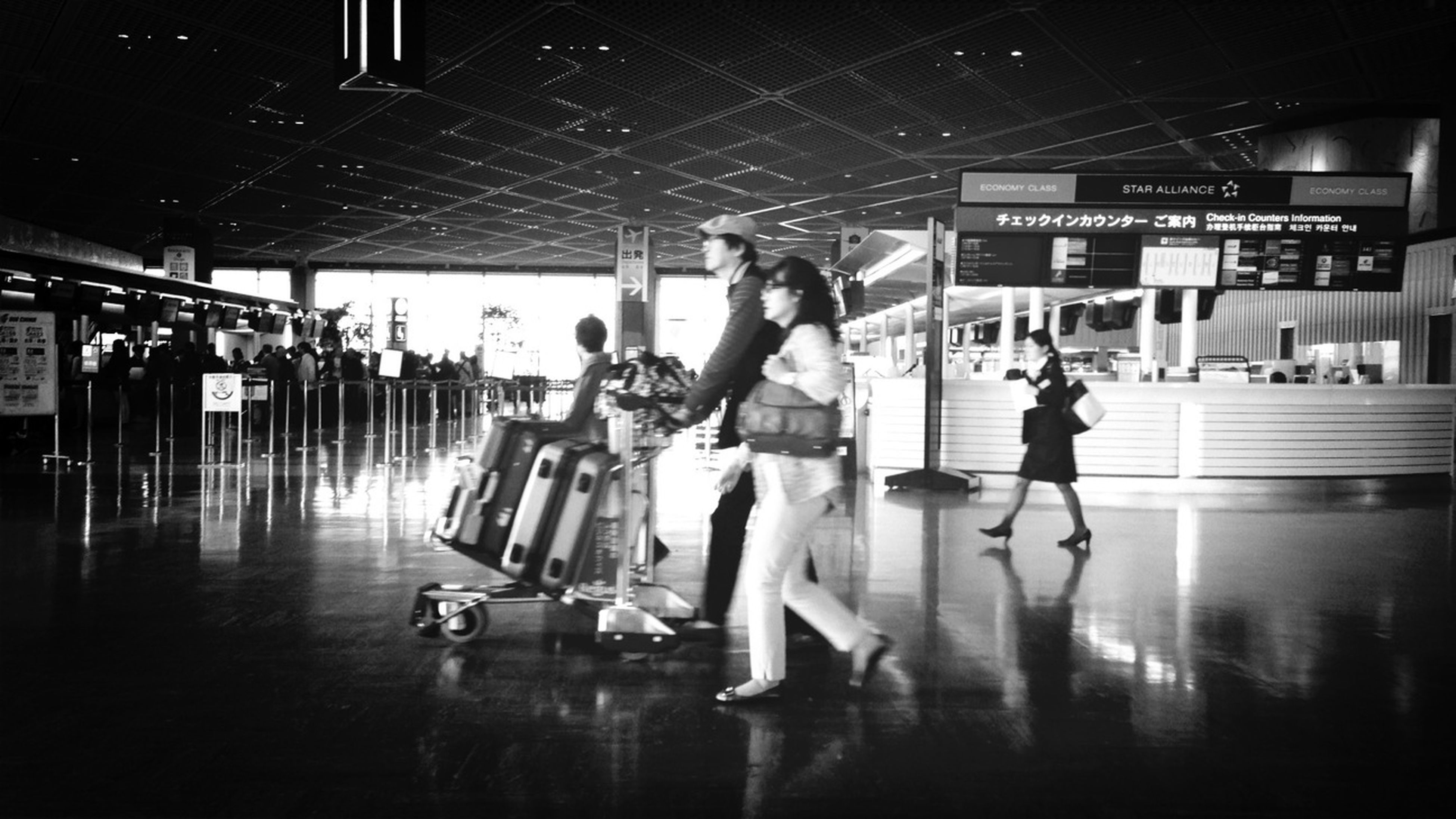 indoors, lifestyles, men, full length, leisure activity, illuminated, person, walking, built structure, architecture, reflection, city life, flooring, ceiling, blurred motion, medium group of people, large group of people, night, subway