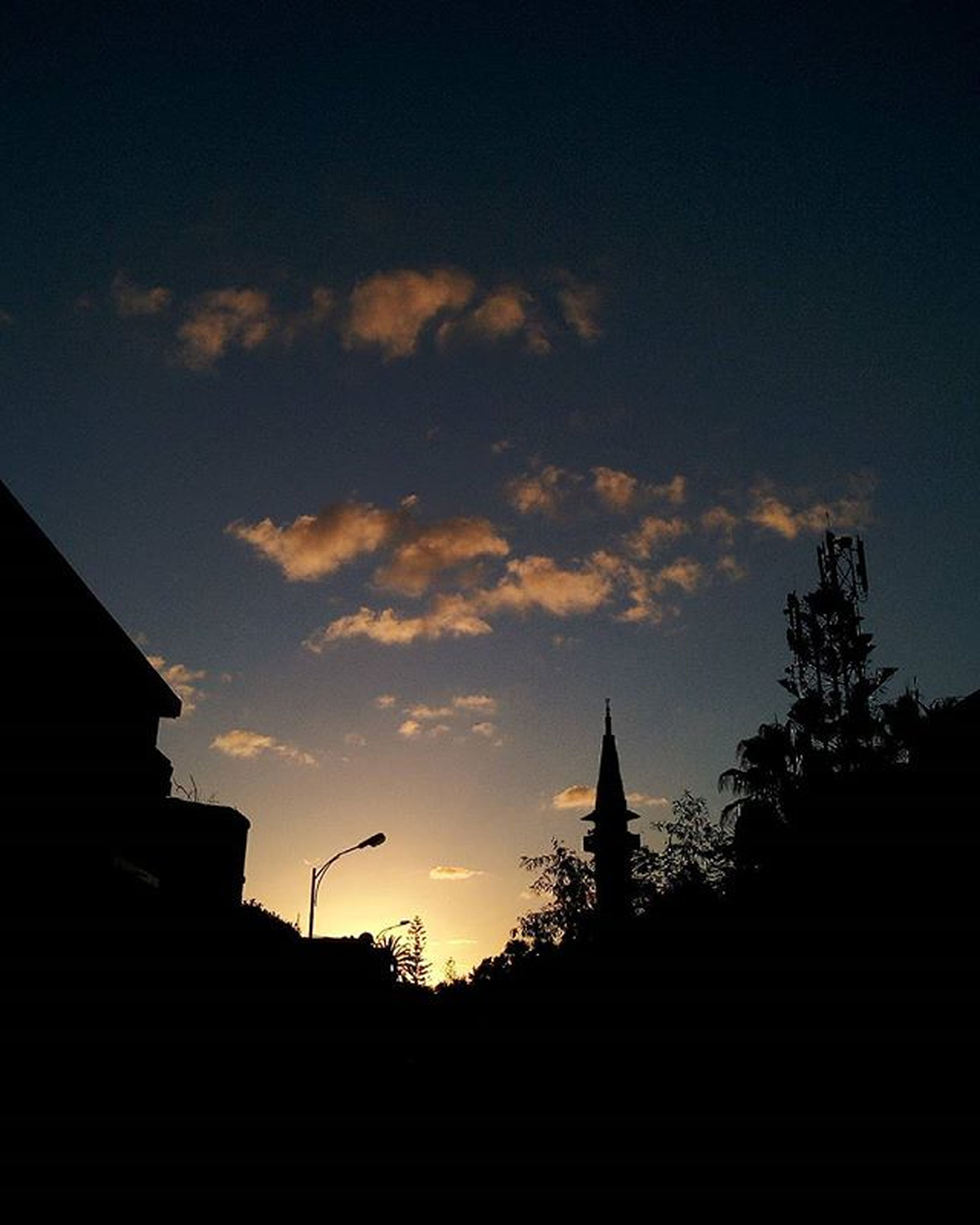 building exterior, silhouette, architecture, built structure, sunset, sky, low angle view, house, building, cloud - sky, tree, dusk, city, residential structure, cloud, residential building, outdoors, no people, nature, outline