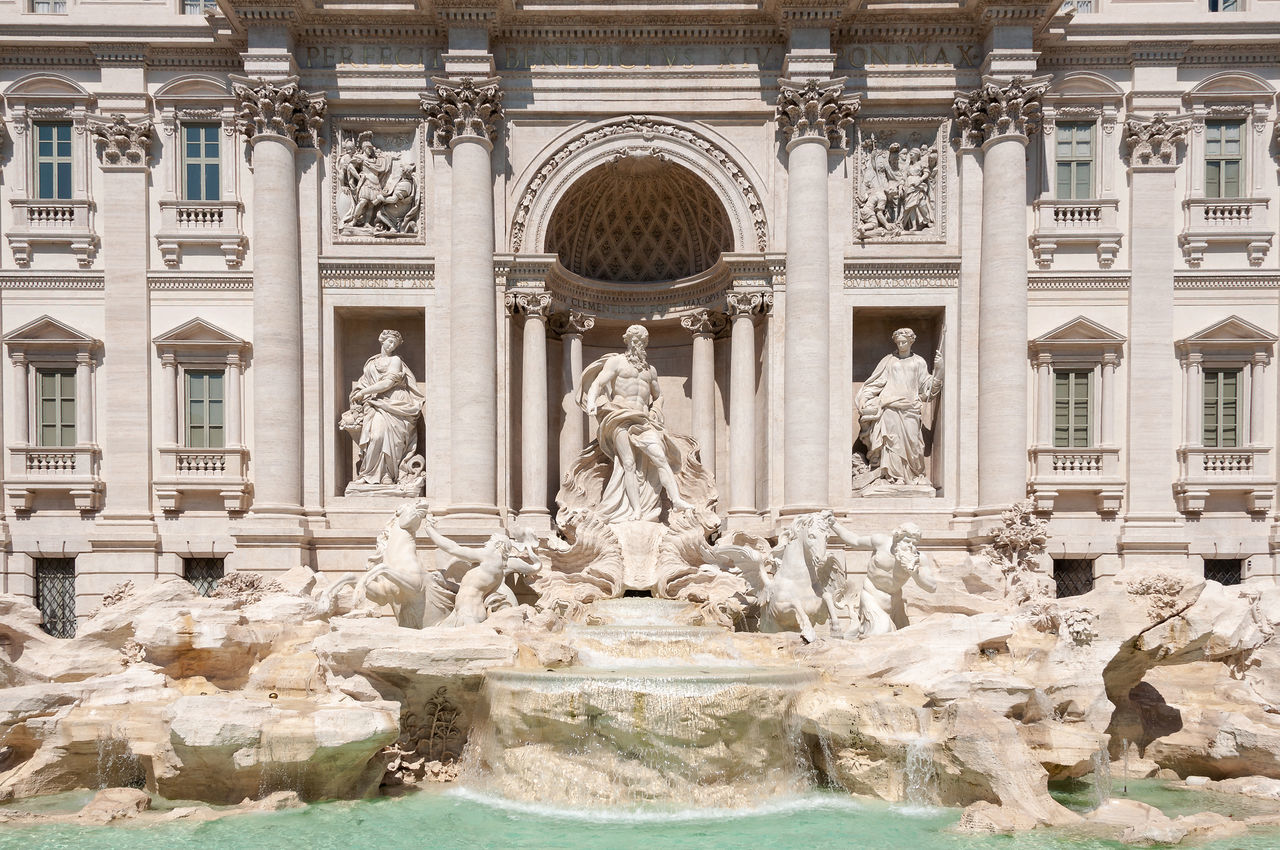 statue, sculpture, fountain, architecture, human representation, art and craft, travel destinations, built structure, building exterior, history, outdoors, architectural column, tourism, marble, water, day, baroque style, renaissance, no people