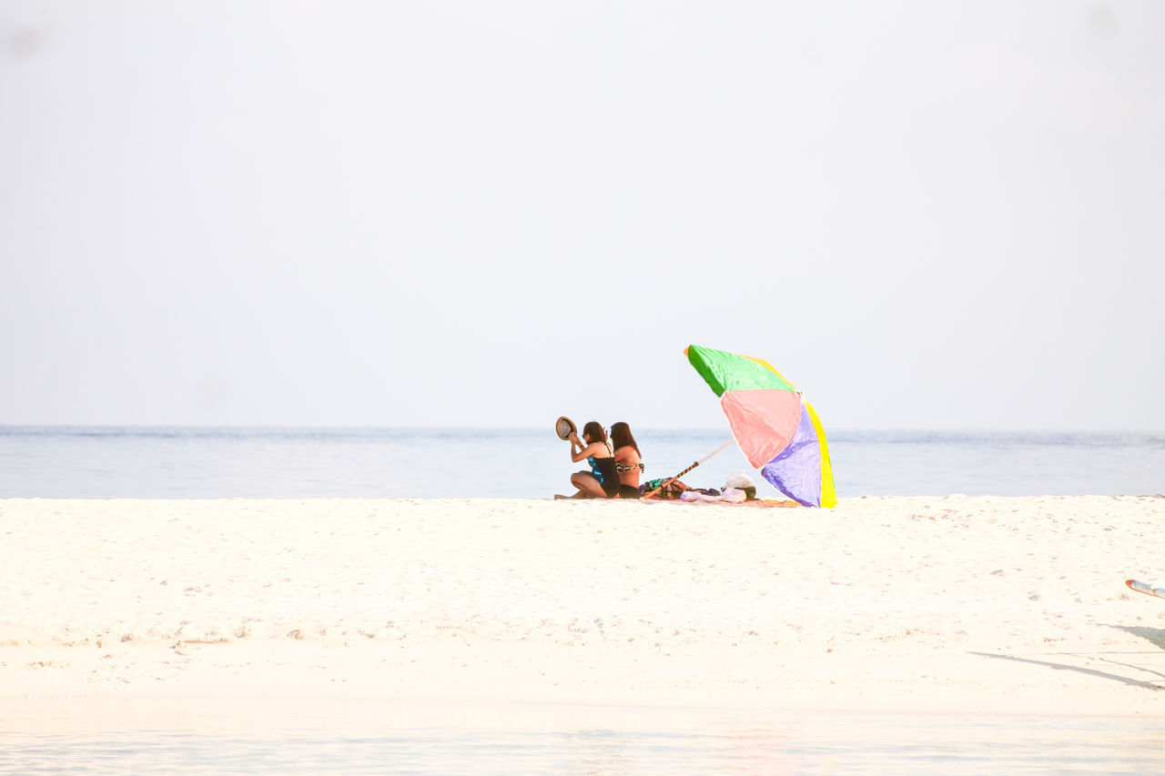 Copy Space Minimalism Summer Vacation White Sand Beach Beach Umbrella Two Girls Sunbathing Summer Time  Water Full Length Sea People Leisure Activity Peace And Quiet Relaxing