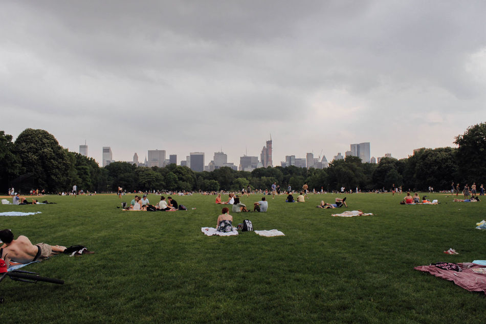 New York City, May 2012 Architecture Building Exterior Built Structure Central Park City Cityscape Cloud - Sky Cloudy Day Grass Green Color Growth Large Group Of People Lawn Leisure Activity New York Park - Man Made Space Person Relaxation Resting Sky Skyscraper Tranquility Urban Skyline Weekend Activities