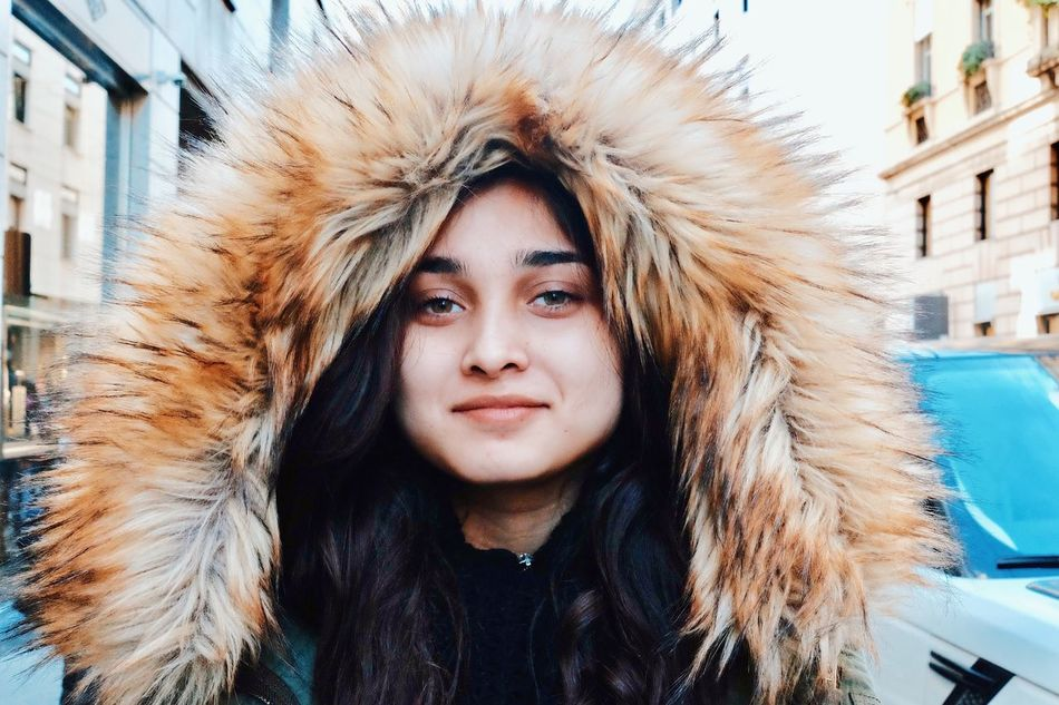Under the hood. Young Adult Building Exterior One Person Headshot Long Hair Portrait Cold Temperature Front View Fur Outdoors Only Women Young Women Beautiful Woman Females Real People Beauty Brick Wall Hood - Clothing Adult Winter