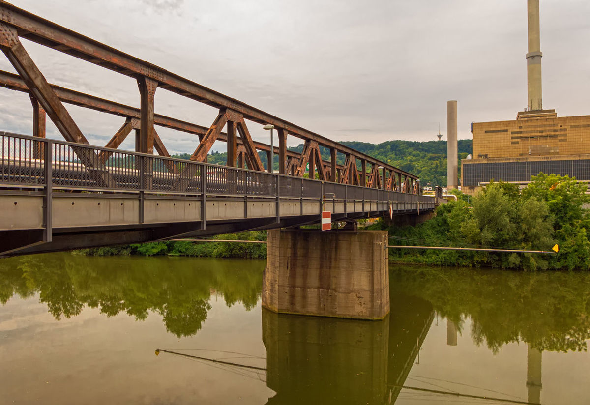 a big bridge leading to the other side of the river Architecture Bridge Bridge - Man Made Structure Built Structure Connection Day Engineering Footbridge Nature No People Outdoors Rail Transportation Reflection River Sky Train - Vehicle Transportation Water