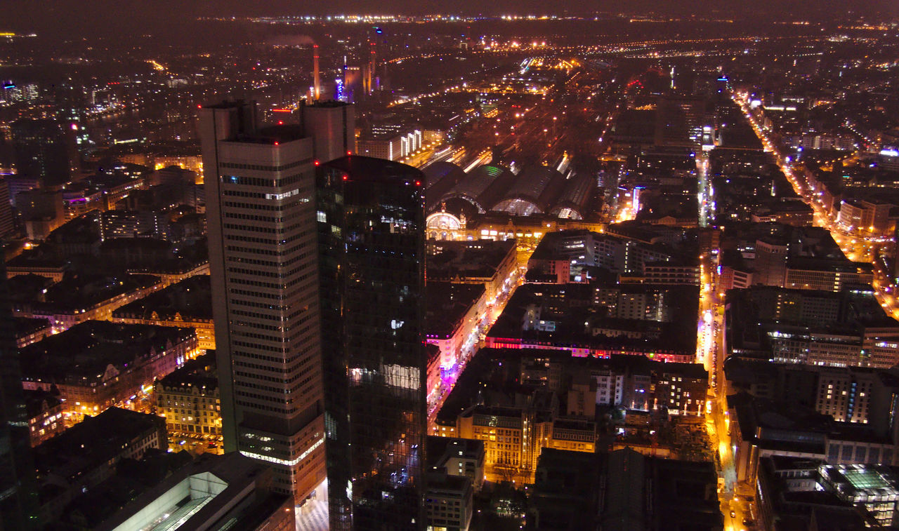 illuminated, city, architecture, skyscraper, building exterior, cityscape, night, built structure, crowded, modern, outdoors, city life, urban skyline, travel destinations, sky