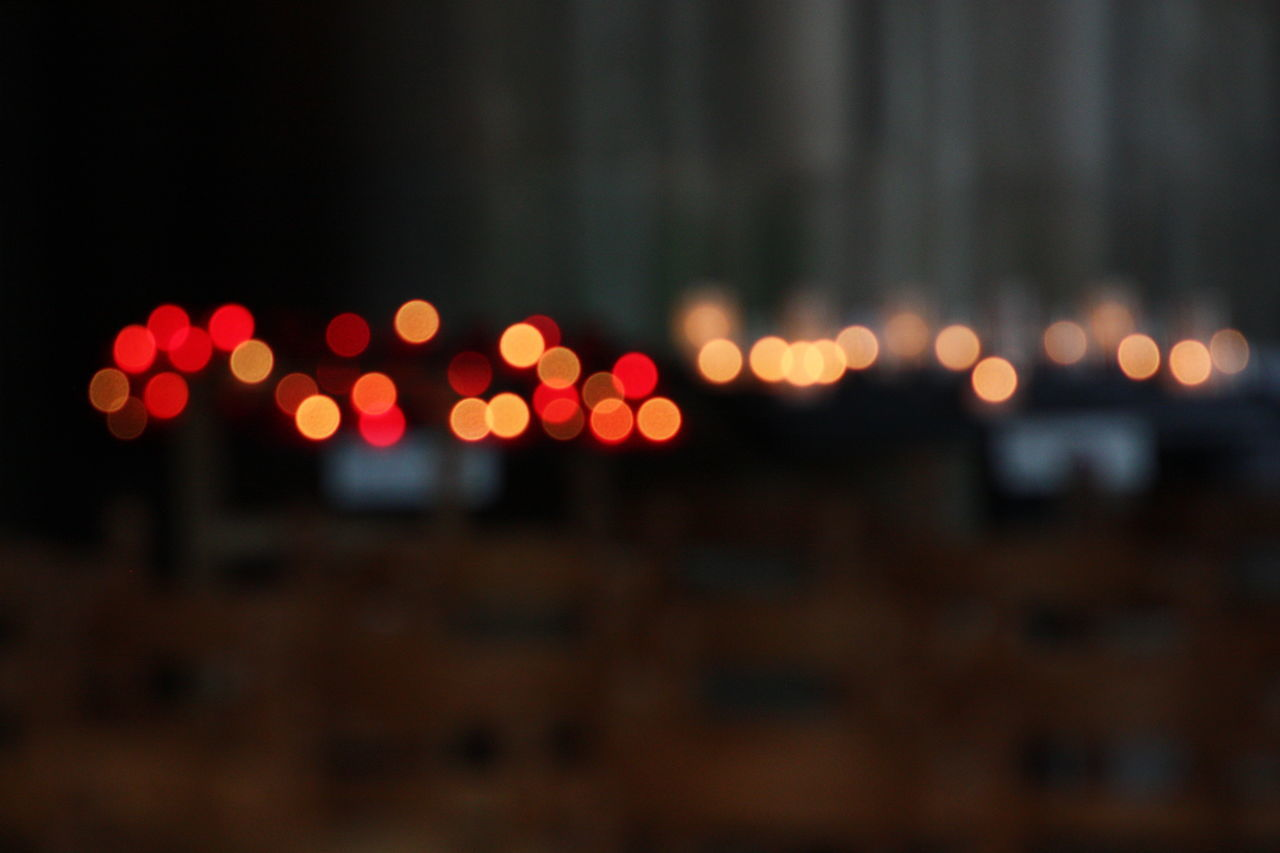 illuminated, night, lighting equipment, no people, defocused, road, outdoors, close-up, city, sky