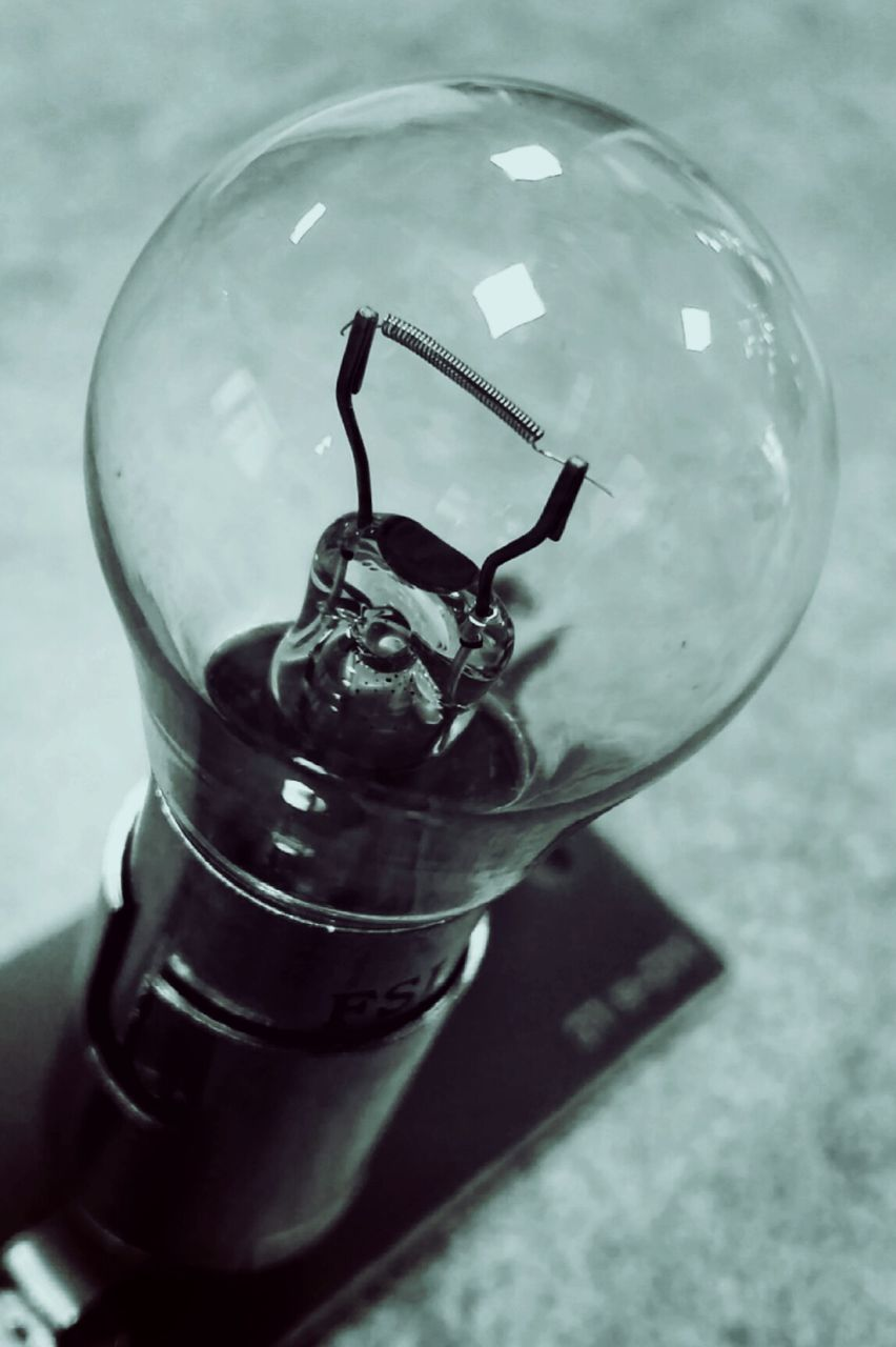 transparent, glass - material, close-up, still life, no people, focus on foreground, indoors, light bulb, filament, day