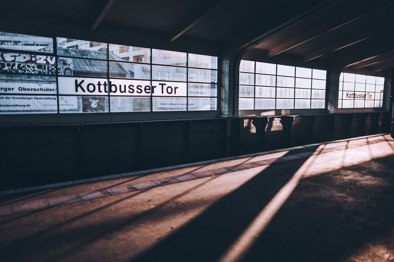 6AM in Kottbusser Tor Architecture Berlin built structure Colors Cool day Exploring indoors Light light and shadow no people Public Transportation rail transportation railroad station railroad station platform Railroad Track sunset Text Transportation
