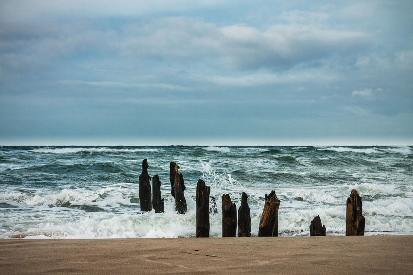 Groynes on shore of the Baltic Sea. Baltic Sea Beauty In Nature Clouds Coast Day Groyne Kühlungsborn Landscape Nature Nature No People Outdoors Scenics Shore Sky Water Waves