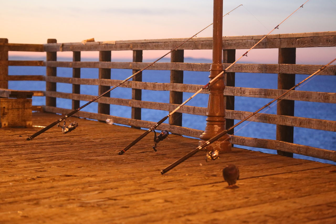 Early Morning Fishing Rods Meditation No People Ocean Outdoors Pier Reiling Tranquility Water Wooden Railing