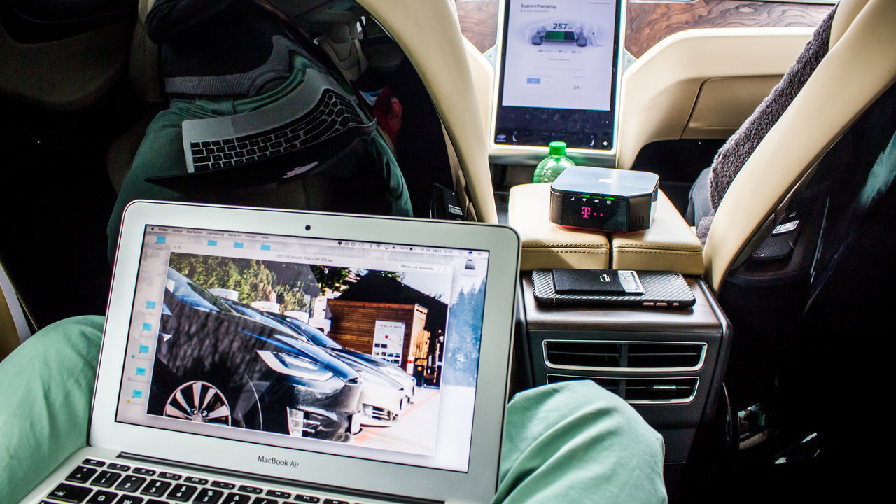 technology, wireless technology, vehicle interior, communication, computer, connection, laptop, portable information device, mobile phone, screen, transportation, vehicle seat, indoors, device screen, telecommunications equipment, using laptop, real people, sitting, touch screen, day, keyboard