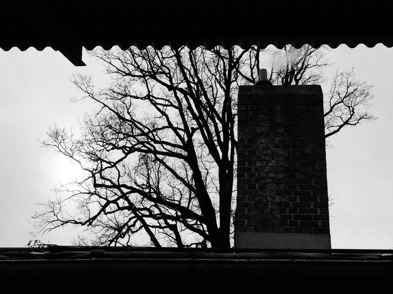 Showcase March Streetphotography Urban Capture The Moment Still Life Grey Sky Blackandwhite Sad Melancholy Cityscapes Architecture OutsideBuilding Exterior Chimney Tree Winter Cloudy Silhouette Learn & Shoot: Simplicity Learn & Shoot: Leading Lines From My Point Of View Different Perspective Structure Thoughts Wintertime