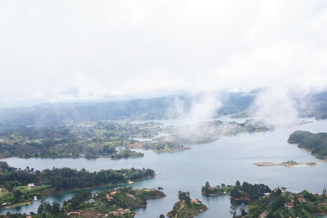 Guatape Colombia 7 Bluewater Whiteclouds Farview Guatapé Reservoir Colombia Boat At Far Birdview Beauty In Nature Scenics Nature Water No People High Angle View Day Outdoors Tree Sky Tranquility Mountain