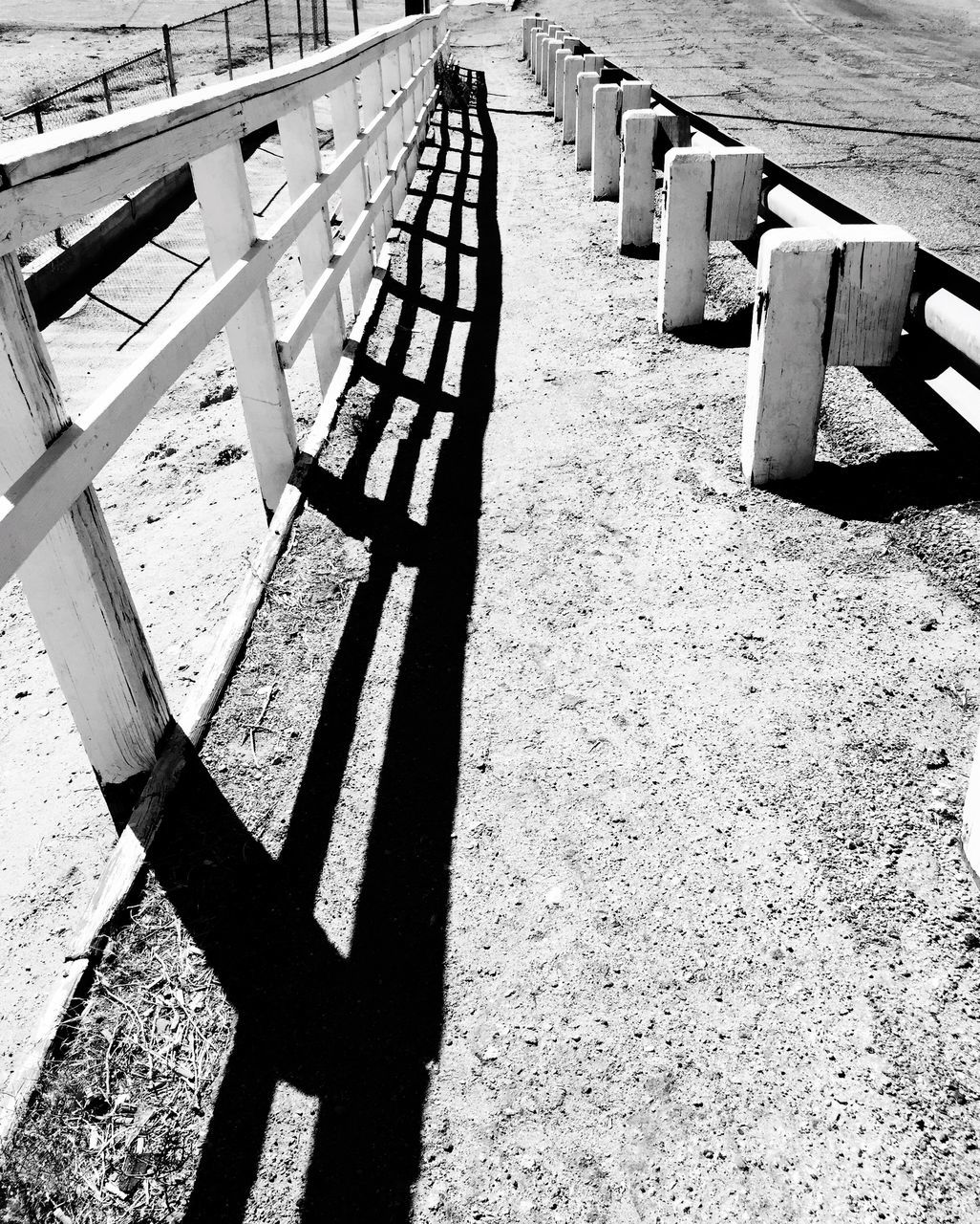shadow, sunlight, high angle view, day, wood - material, no people, outdoors, sand, seat, nature