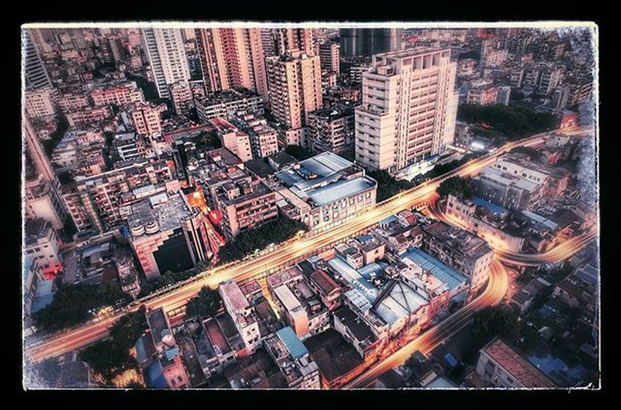 city, building exterior, cityscape, architecture, skyscraper, illuminated, night, built structure, aerial view, modern, high angle view, no people, city life, outdoors, urban skyline, sky