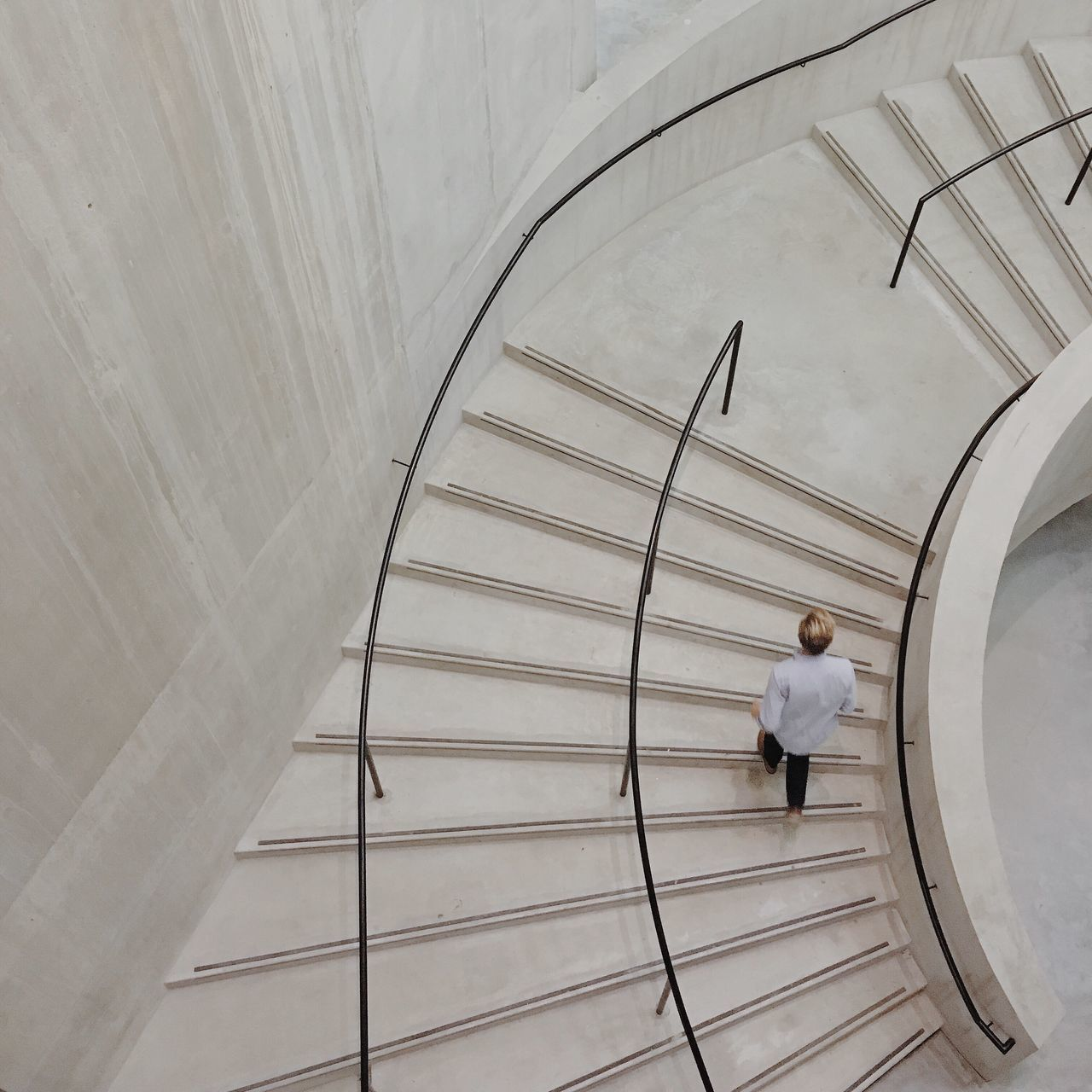 one person, architecture, full length, spiral, real people, one man only, standing, steps and staircases, built structure, steps, staircase, rear view, men, only men, adults only, concentric, day, outdoors, people, adult, astronomy