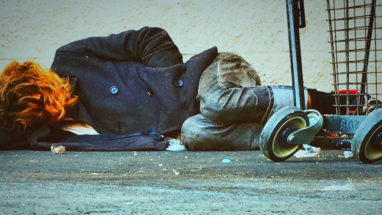 """If I could just rest"". Man Sleeping Life On The Streets Social Issues Hard Crime Beatings Illness Luck Fear No Rest Alone Pain Outdoors Day Ground Level View Snap A Stranger"