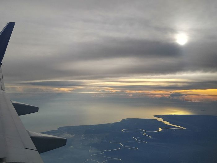 Been There. Horizon Over Water Cloud - Sky Water Sunset Outdoors Aerial View Sky Nature Beauty In Nature View From An Airplane Window Travel Travel Photography Airplaneview Airplane Wing