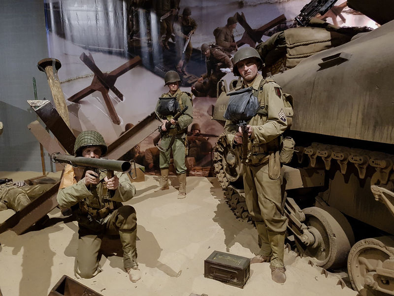 Overlord Museum, Colleville-sur-mer, Normandy, France, July 2017 D-Day II War World. Overlord Museum American Soldiers Army Soldier Bazooka Camouflage Clothing Exhibition Exhibits Exposure Military Museum Omaha Beach Overlord Sherman Tank Standing Weapon