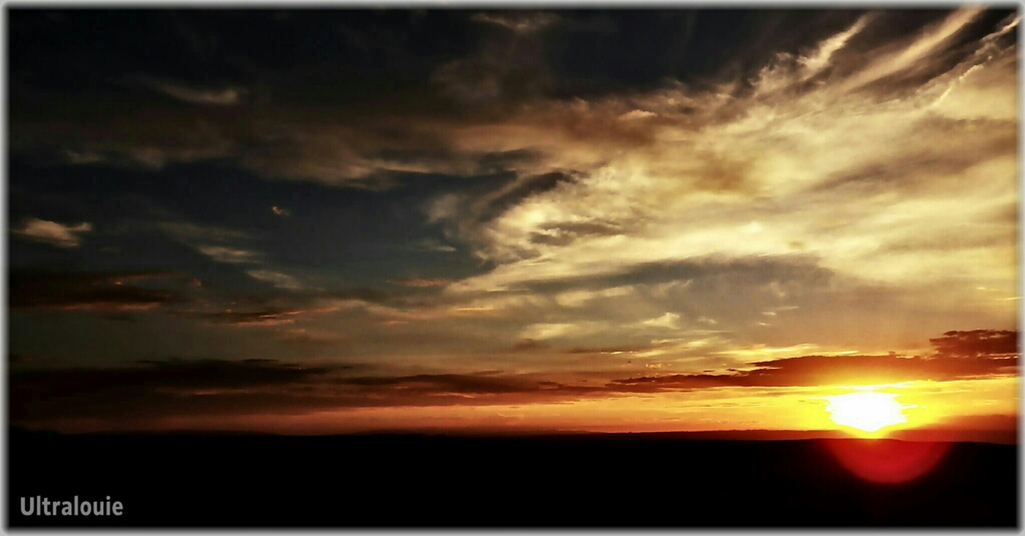 sunset, transfer print, sky, scenics, silhouette, beauty in nature, tranquil scene, sun, tranquility, orange color, cloud - sky, auto post production filter, nature, idyllic, dramatic sky, cloud, sunlight, landscape, moody sky, cloudy