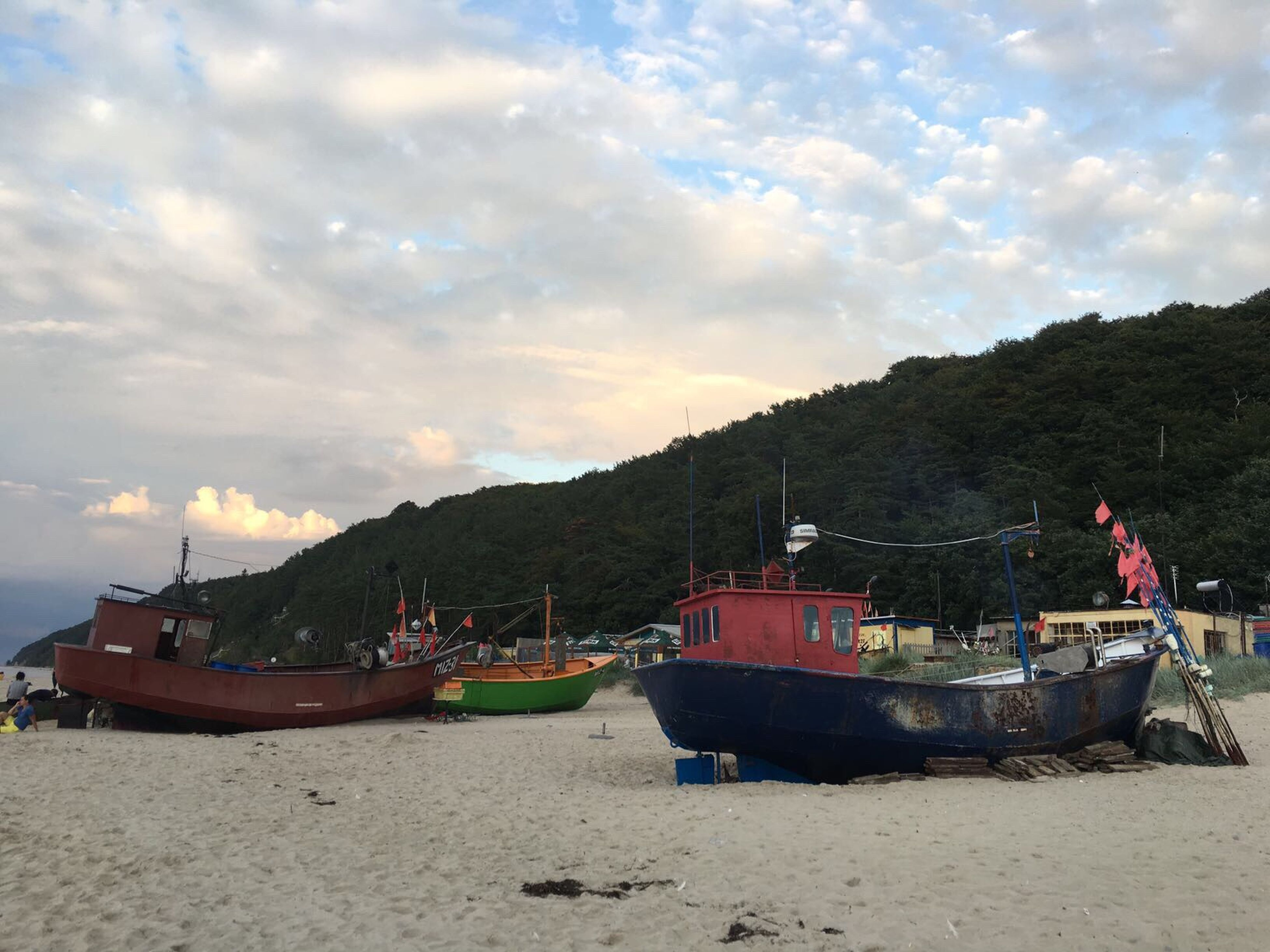 nautical vessel, transportation, boat, mode of transport, moored, water, sea, sky, calm, shore, cloud, tranquility, mountain, tranquil scene, cloudy, cloud - sky, ocean, coastline, fishing boat, nature, ship, day, scenics, outdoors, no people, waterfront, mountain range, tourism, lakeside