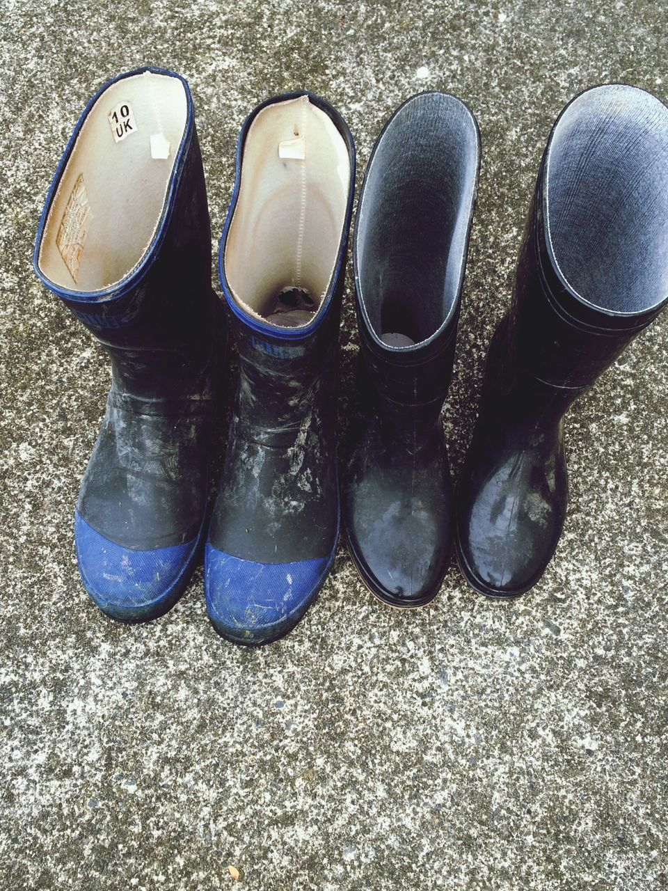 High Angle View Of Rubber Boots On Street