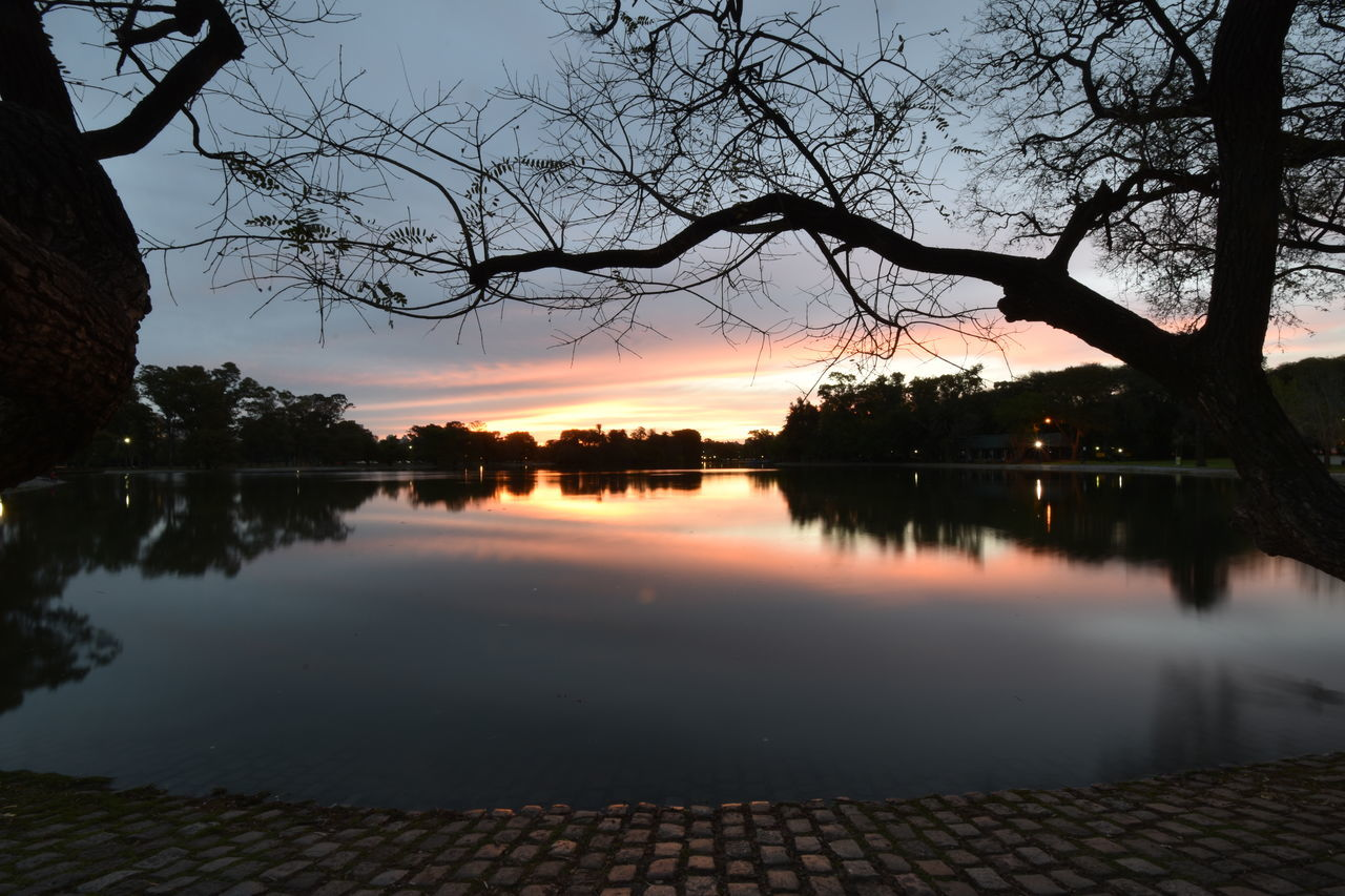 Sunset in Buenos Aires #City #Dark #lights #moody #urban Calm Lake Moody Sky Reflection Scenics Silhouette Sky Sun Sunset Sunset_collection Sunsets Tourism Tree Water Long Exposure Buenos Aires Buenosaires