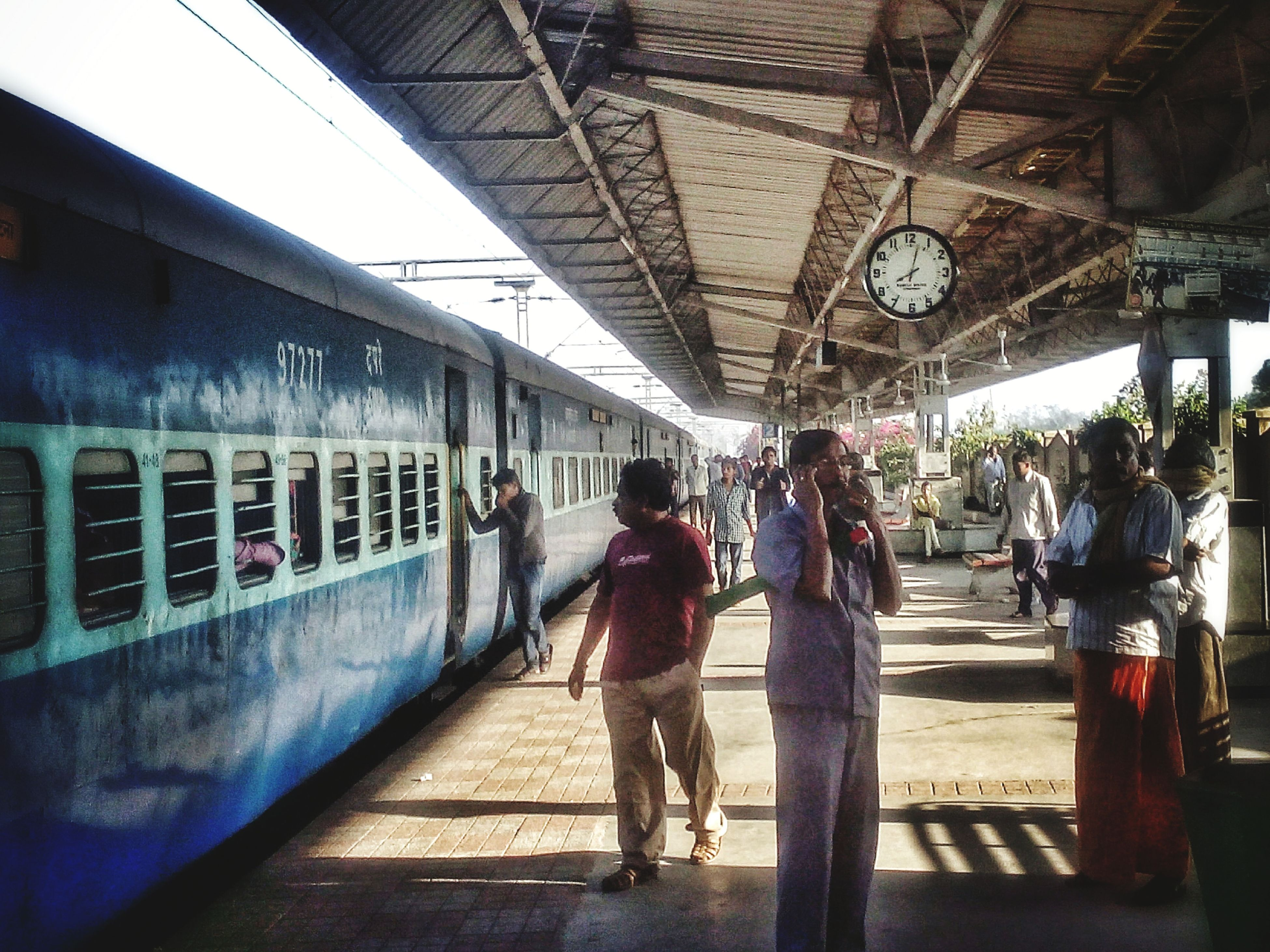 indoors, men, lifestyles, person, leisure activity, full length, railroad station, walking, architecture, public transportation, travel, ceiling, built structure, rail transportation, transportation, passenger, railroad station platform, rear view, casual clothing