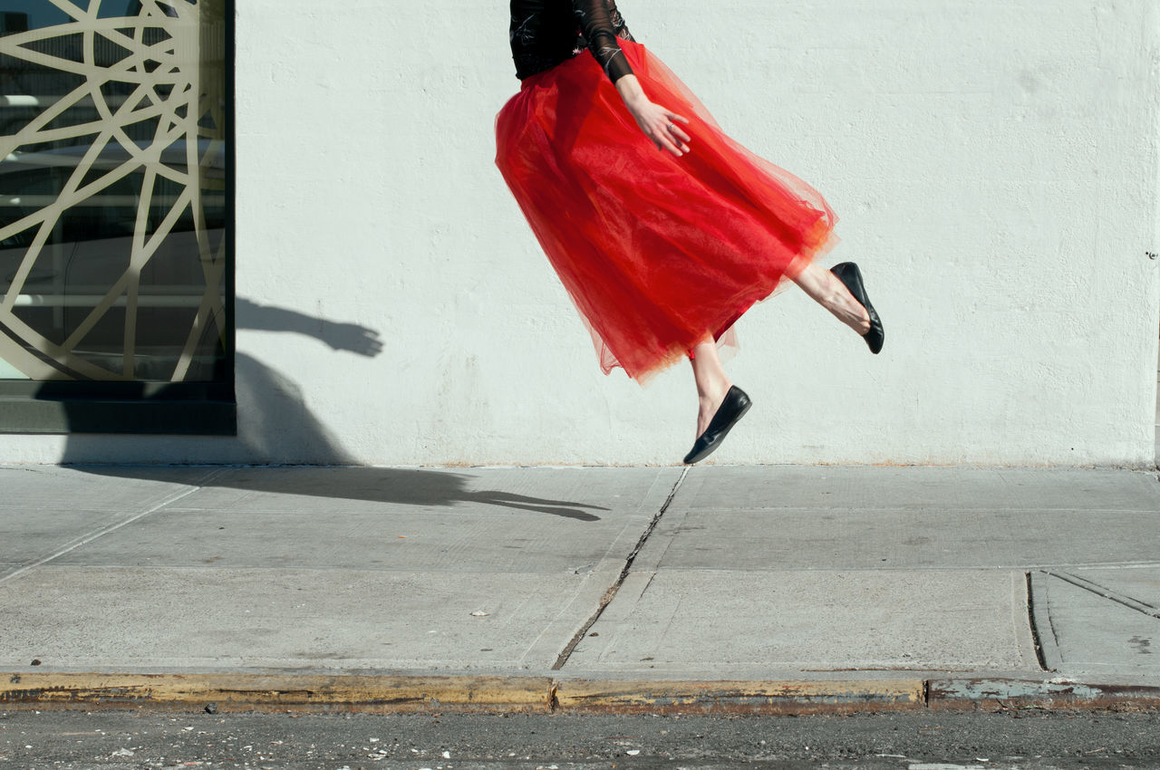 Flying around Williamsburg with Elizabeth Potter City conceptual Dance eye4photography EyeEm Best Shots EyeEm gallery full length legs motion one person outdoors Red