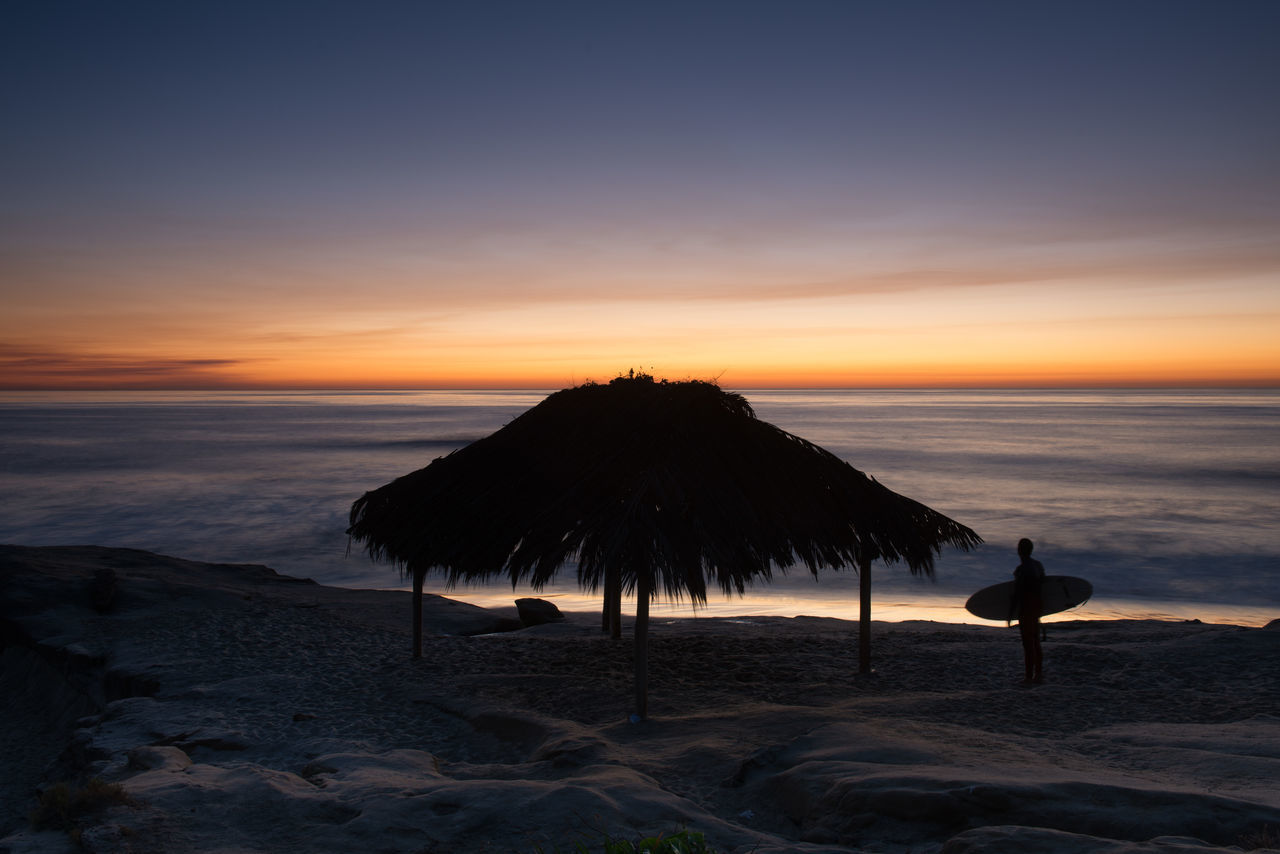 Windandsea Shack with surfer at sunset. Beach Beauty In Nature Coastline Day Horizon Over Water Nature No People Outdoors Peaceful View S Sand Scenics Sea Sky Sunset Surf Shack Surfing Tranquility Windandse
