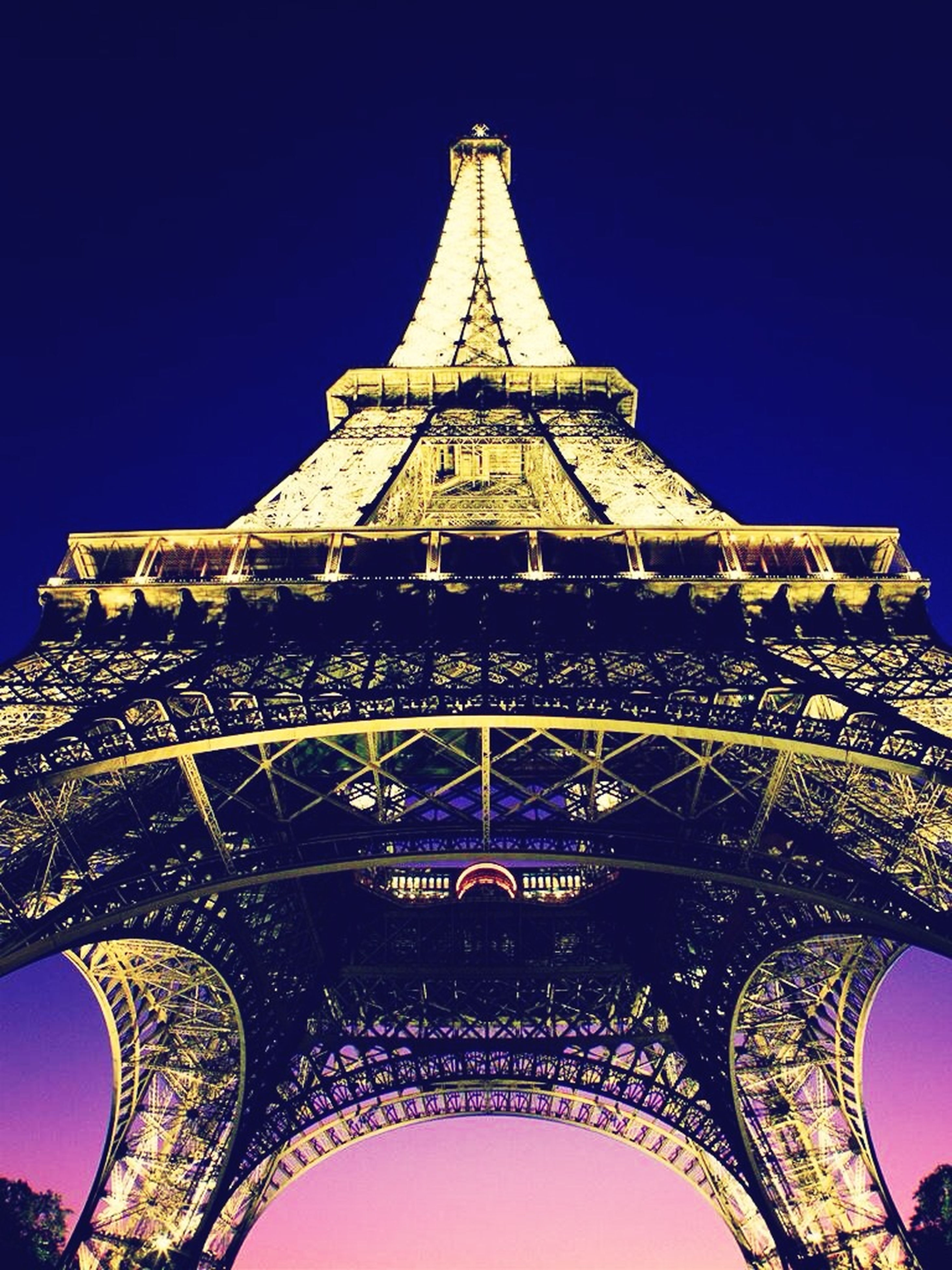 architecture, famous place, low angle view, built structure, international landmark, travel destinations, tourism, travel, capital cities, building exterior, tower, clear sky, religion, place of worship, history, architectural feature, spirituality, blue, eiffel tower, sky