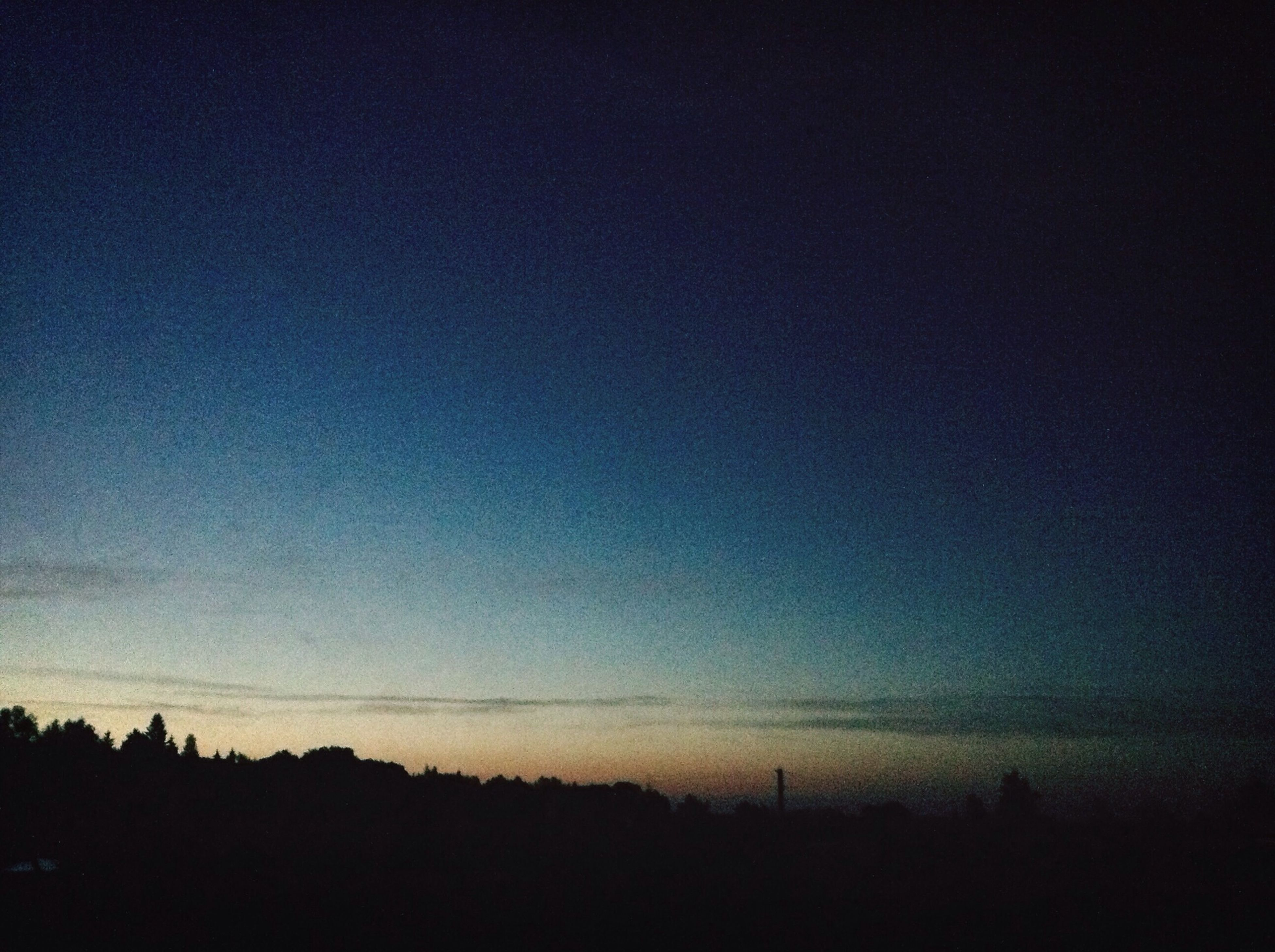 silhouette, tranquility, tranquil scene, scenics, copy space, beauty in nature, tree, sunset, landscape, nature, sky, dusk, dark, clear sky, blue, idyllic, outdoors, outline, no people, power line