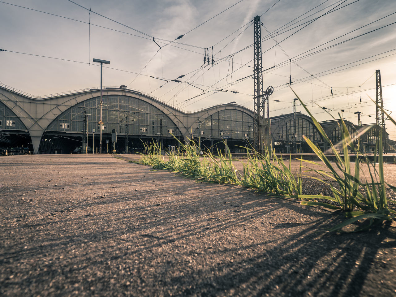Look at the bottom of station. The nature is there :-) Architecture Bahnhof Building Exterior Built Structure Cable Connection Day Electricity  Electricity Pylon Leipzig Light And Shadow Nature No People Outdoors Road Sky Stationary Sunlight And Shadow The Way Forward Transportation