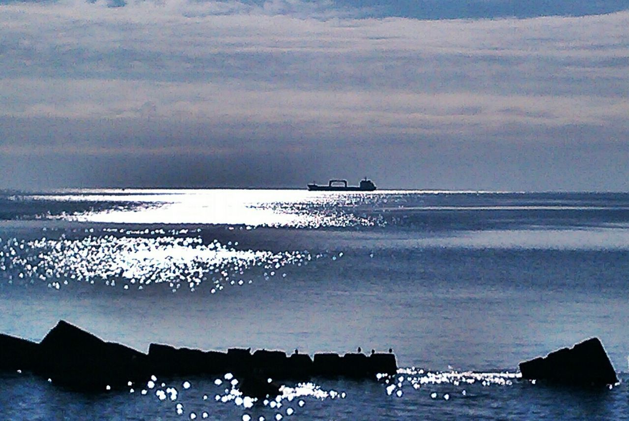 sea, water, horizon over water, scenics, beauty in nature, nature, beach, tranquility, sky, nautical vessel, tranquil scene, transportation, cloud - sky, sunset, no people, outdoors, silhouette, wave, day