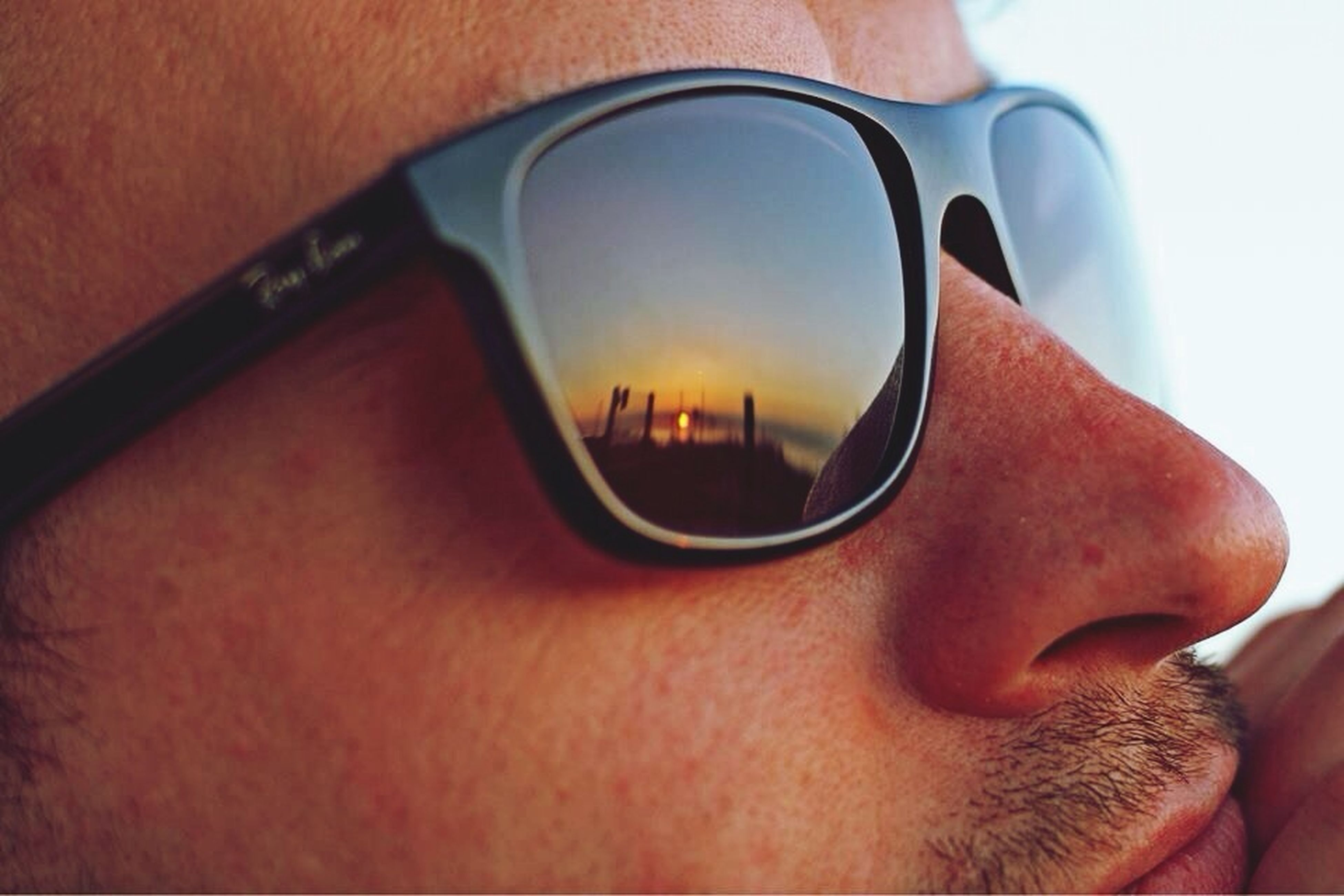lifestyles, leisure activity, part of, sunglasses, transportation, mode of transport, reflection, men, close-up, cropped, holding, person, sitting, unrecognizable person, travel, car