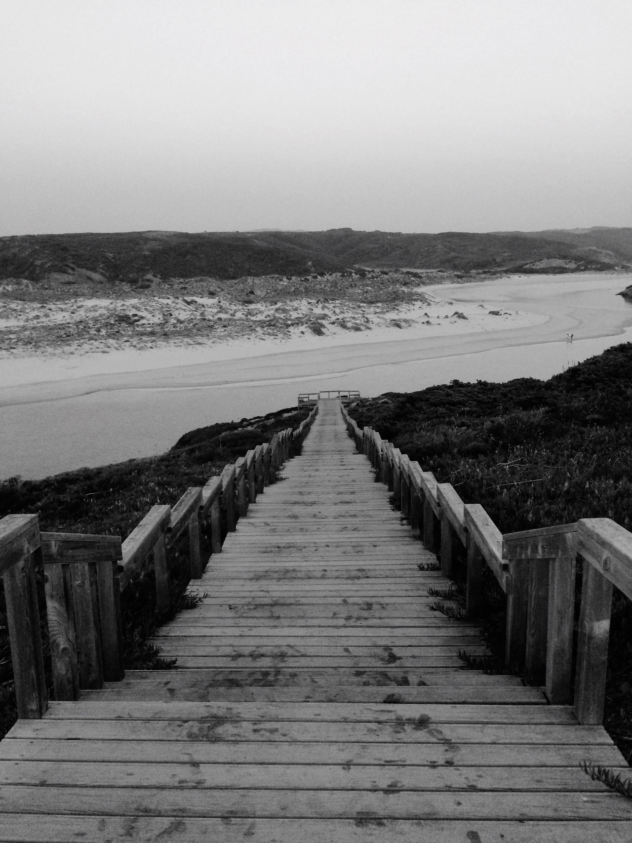 Monochrome Photography Nature Sea The Way Forward Tranquil Scene Clear Sky Beach Beauty In Nature Tranquility Scenics Outdoors Boardwalk Day Sky Sand Water No People Portugal Wood Paneling Aljezur