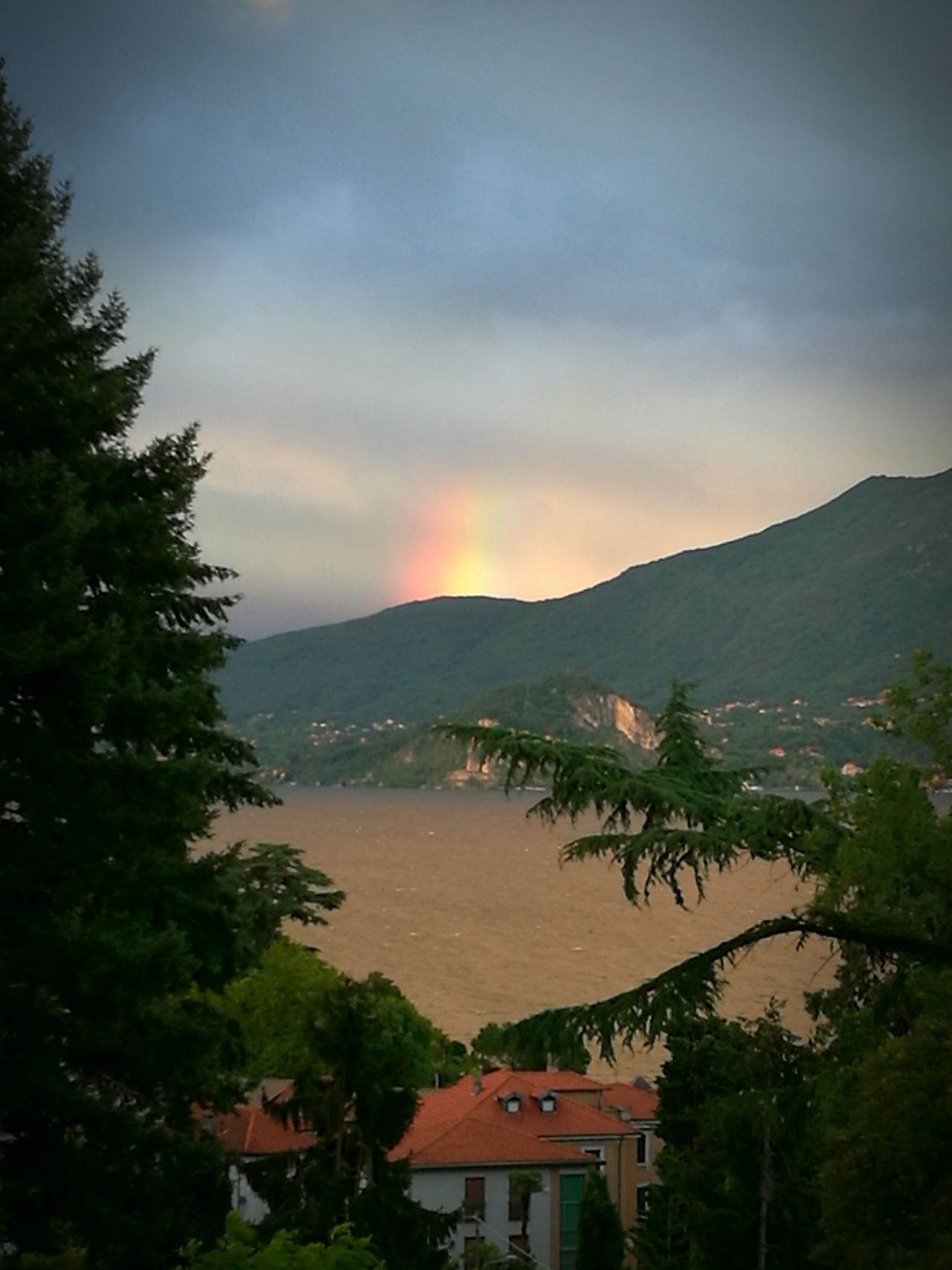 Raimbow Lake View Lake Maggiore Sky And Clouds Sunset And Clouds  Skylight Strange Sunset Colors Summer Storm After The Rain