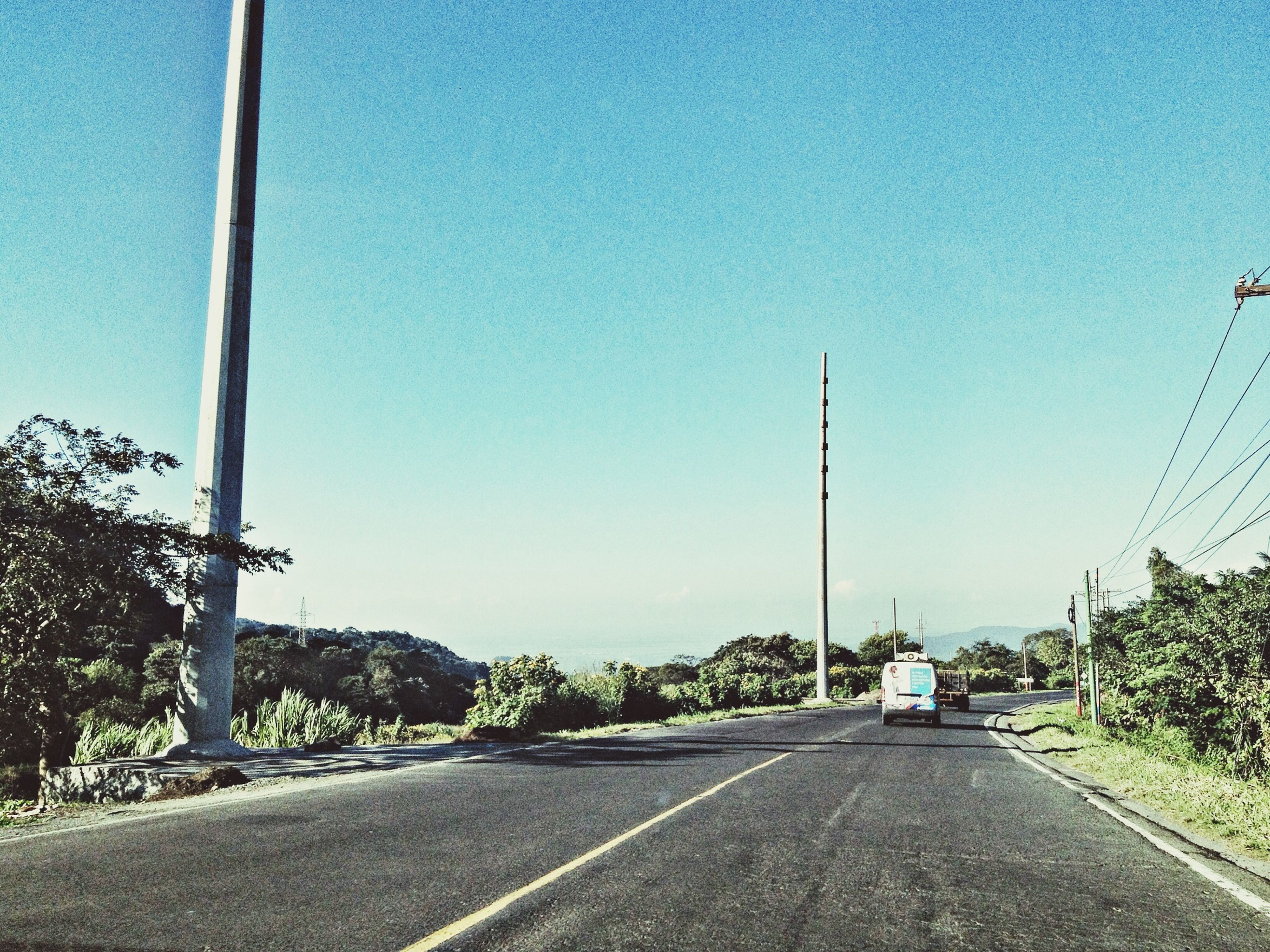 clear sky, the way forward, road, blue, copy space, transportation, road marking, diminishing perspective, tree, street light, empty, street, vanishing point, empty road, country road, long, electricity pylon, power line, day, sky